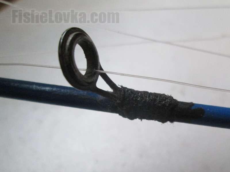 Примотанное нитками с покрытием черным лаком кольцо.
